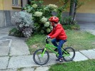 Gio, the boy who could not walk, now rides his bike to school